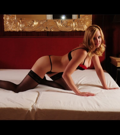 Escort Lady Klara on the bed